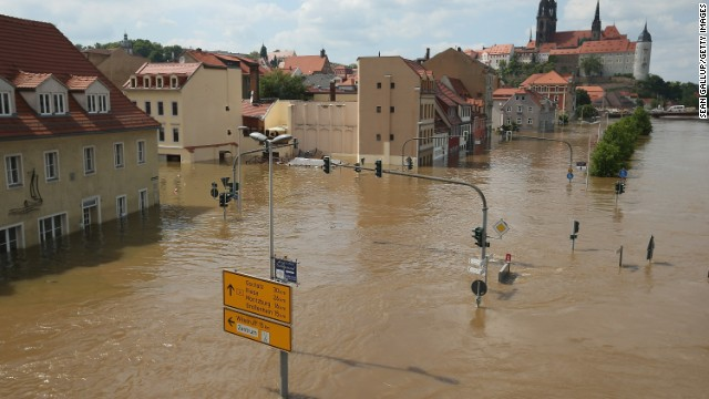 Firemen evacuate residents in a rubber boat from the Halle Neustadt district flooded by the swollen Saale river on June 6, 2013 in Meissen, Germany. Eastern and southern Germany are suffering under floods that in some cases are the worst in 400 years. At least four people are dead and tens of thousands have evacuated their homes.
